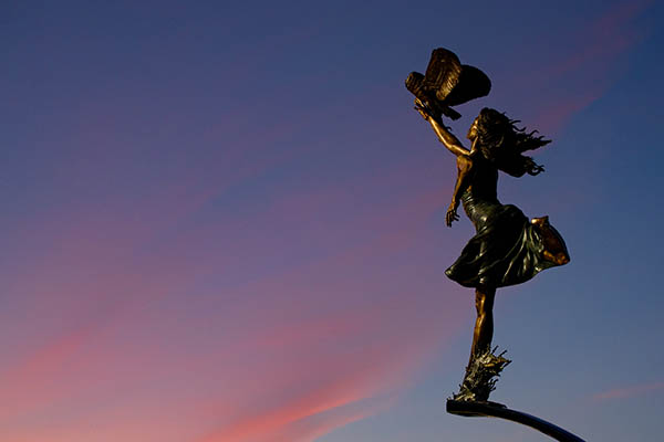 a statue of minerva at sunset