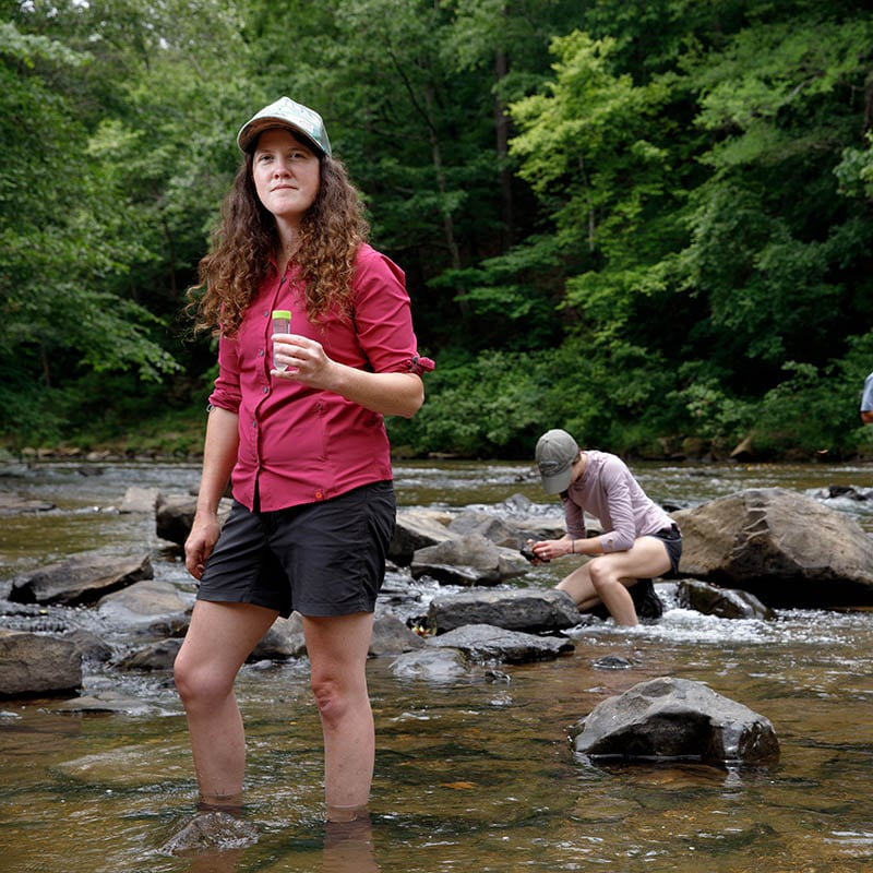 A student stands in Hurricane Creek